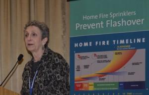 Ruth Balser speaking at podium